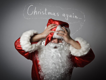 chagrin: Frustrated Santa Claus. Christmas again and other problems. Santa Claus suffering from headache. Stock Photo