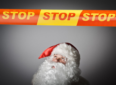restricted area: Santa Claus and STOP line over his head. Restricted area concept.