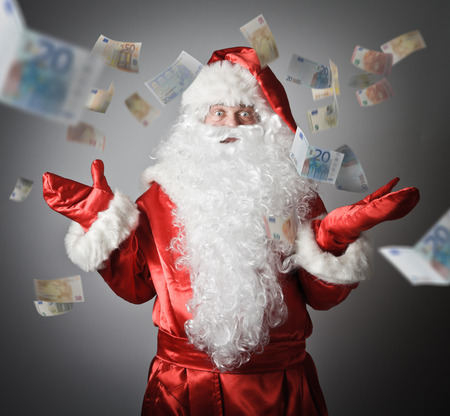 justification: Confusion of a Santa Claus and falling Euro. Lottery concept. Stock Photo