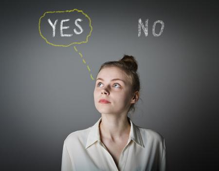 hesitation: Young slim woman full of doubts and hesitation. Yep concept.
