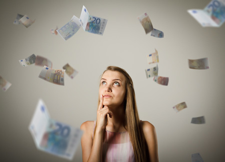 jubilate: Girl and falling euro banknotes. Currency and lottery concept. Young woman is doing something.