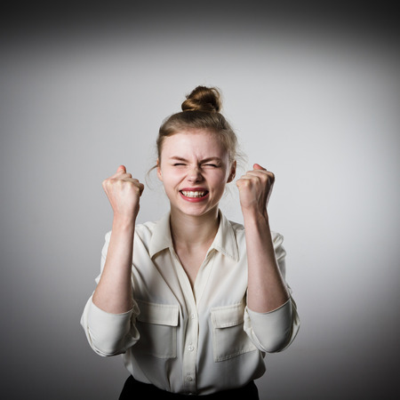 rejoicing: Rejoicing young slim woman. Success and winner concept. Stock Photo
