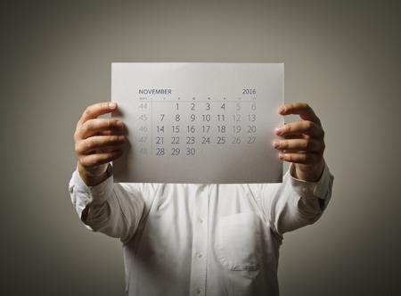 november calendar: Man is holding November calendar of the year two thousand sixteen. Stock Photo