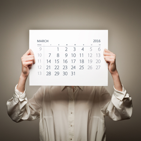 sixteen: Woman is holding March calendar of the year two thousand sixteen. Stock Photo