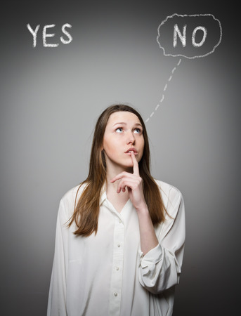 hesitation: Girl in white is full of doubts and hesitation. Yep concept. Stock Photo