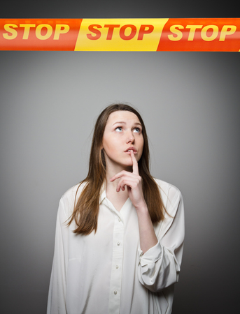 restricted area: Woman and STOP line over her head. Restricted area concept. Stock Photo