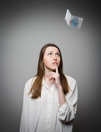 exult: Girl in white and falling twenty euro.
