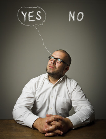 hesitation: Man in white is full of doubts and hesitation. Yep concept. Stock Photo