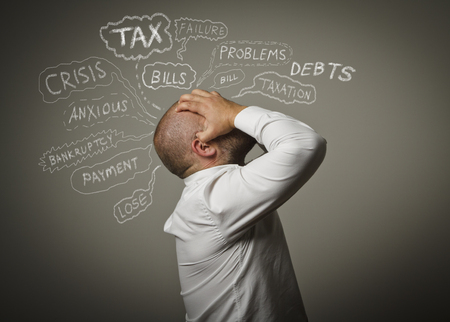 tiring: Frustrated man. Taxes, debts and other problems.