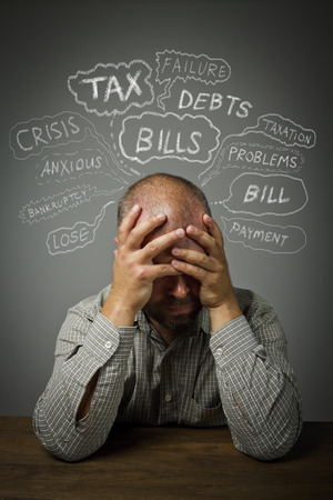 chagrin: Frustrated man. Taxes, debts and other problems.