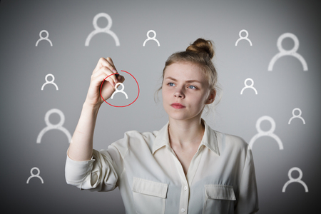 person writing: Young slim woman is writing in social network. One person selection.
