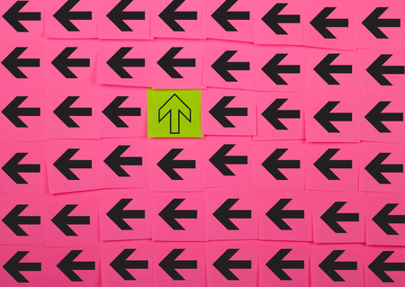 sticky notes: Arrows. Vertical and horizontal concept. Background of pink sticky notes.