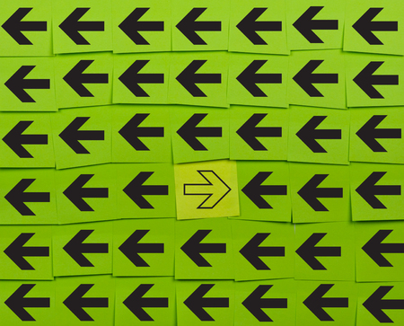and opposite: Arrows. Opposite concept. Background of green sticky notes.
