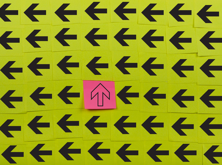oppose: Arrows. Vertical and horizontal concept. Background of green sticky notes.