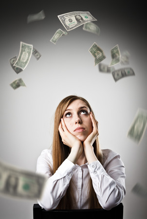 Woman in white and falling dollar banknotes. Currency and lottery concept.