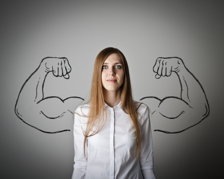 muscled: Woman in white with sketched strong and muscled arms.