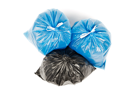 Black and blue garbage bags on white background