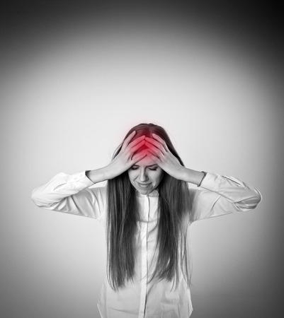 symptom: Headache and symptom concept. Sad and Unhappy woman in white. Tears welled up in her eyes.