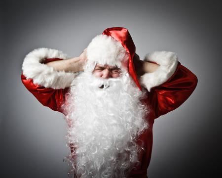 hombre rojo: Frustrado Santa Claus. Santa Claus que sufren de dolor de cabeza.