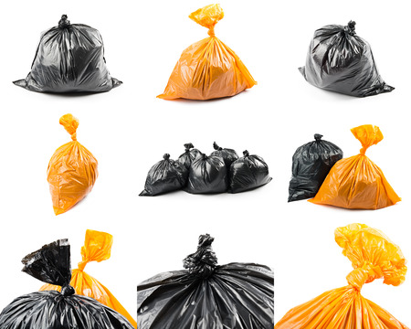 A set of black and orange garbage bags isolated on white background. Collage of garbage bags.