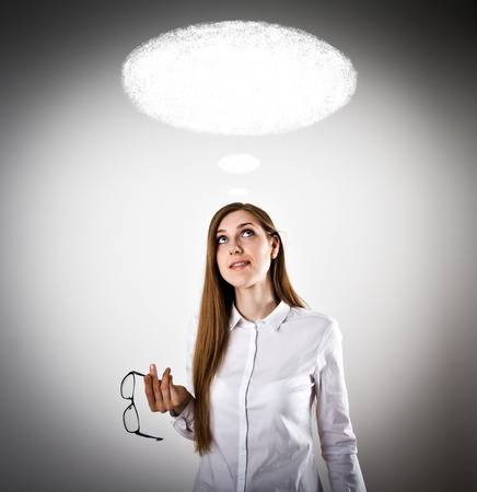 Woman in white is having an idea with blank speech bubble over her head.