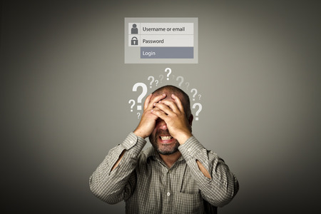 Frustrated man. Forgot password concept. Man suffering from headache. Question-marks.