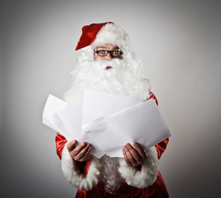 Santa Claus is reading the letters photo