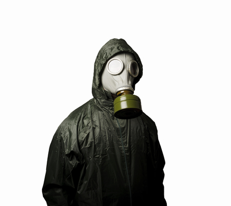Man wearing a gas mask on his face. Gas mask on white background photo