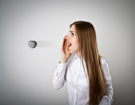Woman in white is screaming at something. Word like a stone in motion - offensive word. A word spoken is past recalling