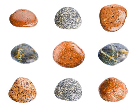 Motley wet sea stones isolated on white background. Set of sea stones.
