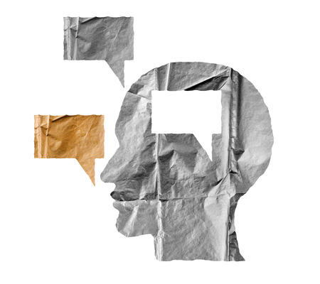 hypocrisy: Crumpled paper shaped as a human head and talk balloon on white background. Speak and opinion concept.