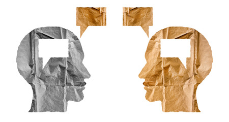 Crumpled paper shaped as a human heads and talk balloons on white background. Conversation, dialogue and opinion concept. Two heads.