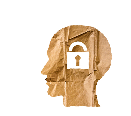 Crumpled paper shaped as a human head and lock on white background. Safety and secrets concept.