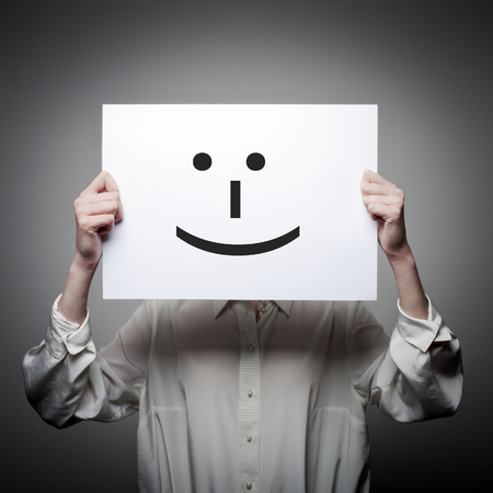 subconsciousness: Woman is holding white paper with smile. Happy concept. Stock Photo