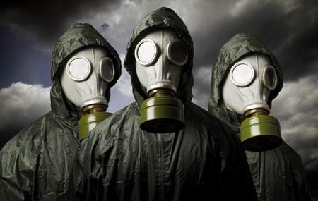 Gas masks and dramatic sky. Survival concept.