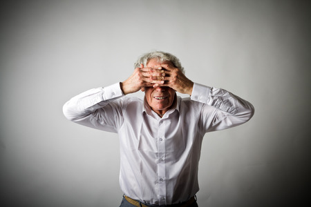 Frustrated. Old man in white is suffering from headache. Expressions, feelings and moods. Stock fotó