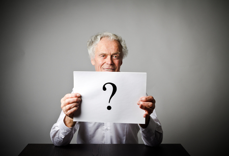 Old man and question mark. Old man in white having no answers to a question. Archivio Fotografico