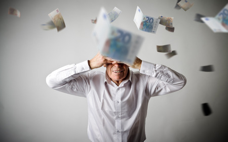 Grief. Old man in white and falling Euro. Business depression and recession concept. Expressions, feelings and moods.   Stock fotó