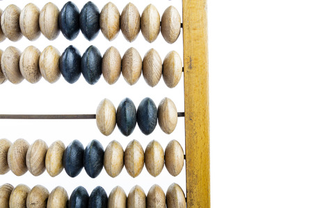 Wooden abacus. Old wooden abacus on bright background. Wooden calculator. Stockfoto