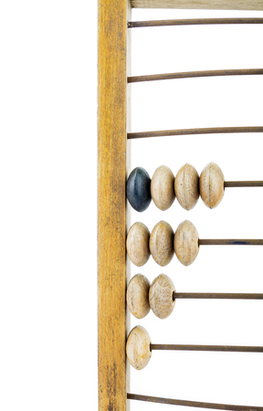 Wooden abacus. Old wooden abacus on bright background. Wooden calculator. Stock fotó