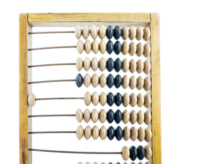 Wooden abacus. Old wooden abacus on bright background. Wooden calculator. 免版税图像