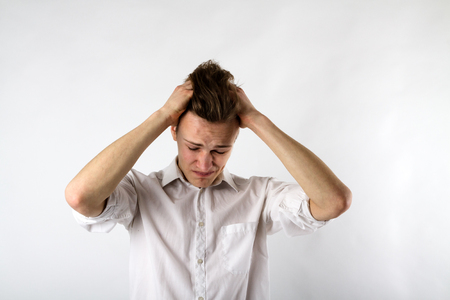 Frustrated. Expressions, feelings and moods. Young man suffering from headache.