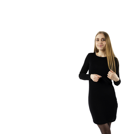 Young attractive woman in black on white background.