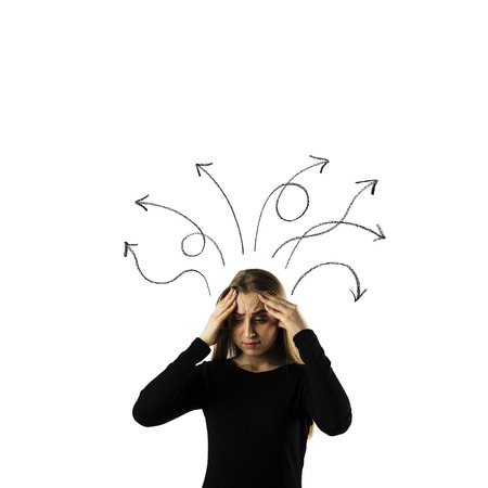 Frustrated young woman in black isolated on white background. Expressions, feelings and moods. Woman solving a problem. Arrows over her head.