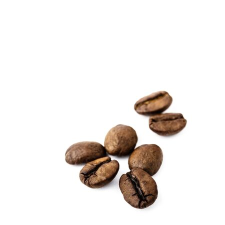 Coffee beans isolated on white background. Macro.
