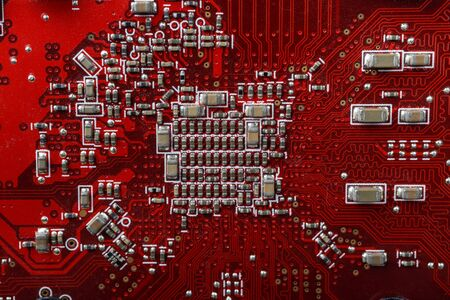 Graphic card. Part of red graphic card as background. Technology and Electronics Industry. Macro.