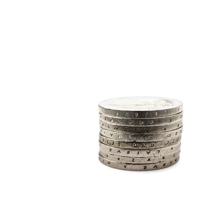 Pile of euro coins isolated on white background. Stack of euro coins. Save money and accumulate wealth. Macro. 스톡 콘텐츠