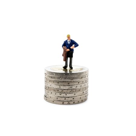 Small figurine and coins isolated on white background. Save money and accumulate wealth. Time is money concept.