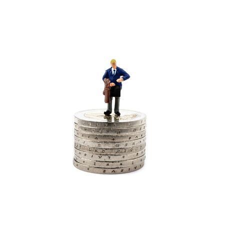 Small figurine and coins isolated on white background. Save money and accumulate wealth. Taxes and social issues. Imagens