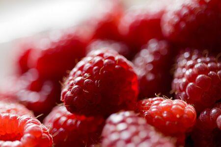 Fresh raspberries in a white plate. Natural raspberries. Macro.